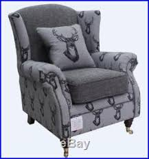 high back wing armchairs ashley fireside high back wing armchair antler stag charcoal grey