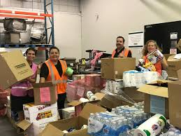 island harvest deploys personnel to puerto rico herald community island harvest food bank employees elizabeth notarbartolo far left migdalia otero jeremy waite
