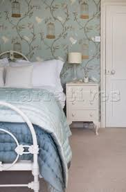 rg011 55 light green and blue quilts on bed in room w