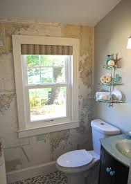inspiring classic bathroom with beige wallpaper and distressed