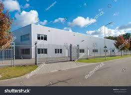 modern exterior industrial building surrounded by stock photo