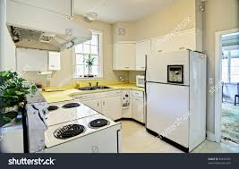 old dated kitchen white appliances yellow stock photo 81615475