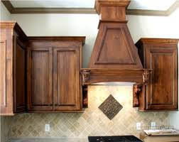 rustic dark wood kitchen cabinets and vent for mexican kitchen