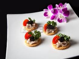made com canapé canape made from biscuit tuna pate tomato pasley and caviar