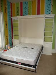 murphy bed queen size with doors open this playroom becomes a