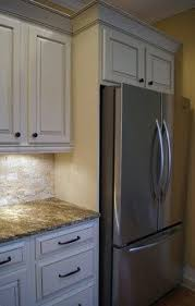 built in refrigerator cabinet refrigerator enclosure to give built in look with glazed cabinets