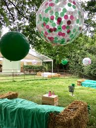 balloons in a box delivery forest green balloons and green pink and white confetti