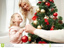 At Home Christmas Trees by Happy Family Decorating Christmas Tree At Home Stock Photo Image