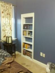bookshelves into french doors to create a secret room image only