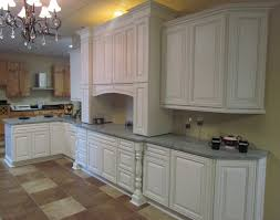 charleston cherry saddle and antique white kitchen cabinets we