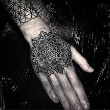 of life mandala tattoo on the hand
