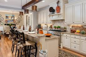 traditional french house galley kitchen with long narrow bar table