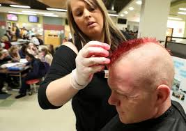 officer haircut grant police officer sports red mohawk cut for good cause