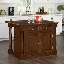 home styles monarch oak kitchen island w granite top