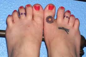small flower tattoo on foot