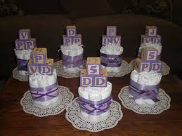 pink and purple baby blocks shower centerpieces diaper cakes