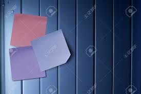 blue and purple notes over a blue painted wooden panel stock photo