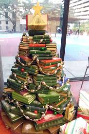 people are using their favourite books to make christmas trees