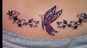flowers and butterfly tattoo on hip