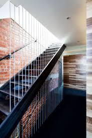 interior minimalist stair railing with wooden floor and wall