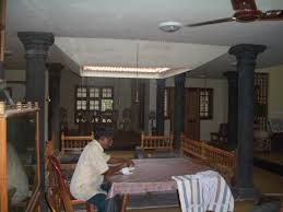 house with nadumuttam and nalukettu style architecture kerala