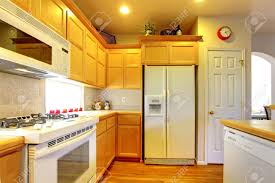 yellow kitchen wood cabinets kitchen with yellow wood cabinets and white appliances and hardwood