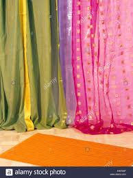 close up of colorful curtains made from sari fabric stock photo