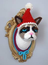 crochet cat in a golden frame with removable hat