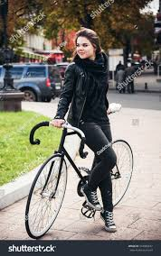 bike riding gear young female riding bicycle fixed stock photo 334985822