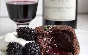 dark chocolate lava cake with blackberry wine sauce edible
