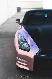 rose gold car nissan gtr wrapped in a custom rose gold chrome created and