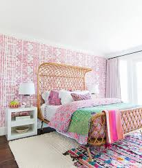 rattan bed with pink wallpaper on bedroom accent wall eclectic