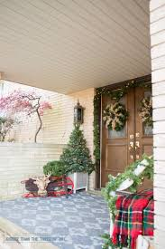 decorating your front porch for christmas bigger than the three