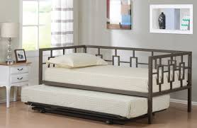 black metal daybed with trundle and white bed sheet on the floor