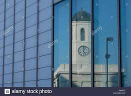 glass front house margate uk clock tower of droit house reflected in the glass