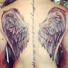 collection of 25 of wings tattoos on back