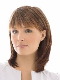 medium length tapered or layered hairstyles for women over 50 long hair with tapered sides tapered bangs that blend into