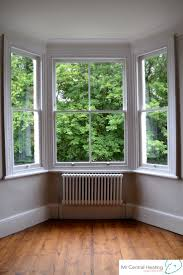 bay home and window creditrestore us white column radiator is a beautiful addition to this bay window