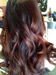 brunette hairstyle with lots of hilights for over 50 60 brilliant brown hair with red highlights