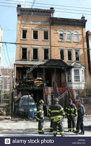 3 alarm fire took over this 3 story building killing 8 kids and