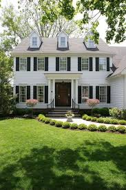Curb Appeal Front Entrance - 7 landscaping tips for beginners colonial concrete facade and