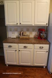 How To Paint Kitchen Cabinets by Texas Decor How We Painted Our Kitchen Cabinets A Tutorial