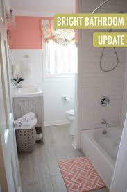 best 25 coral bathroom decor ideas on pinterest coral bathroom the combination of wainscoting coated in ultra pure white behr paint with pops of coral gives bathroom updatesbathroom remodelingbathroom ideascoral