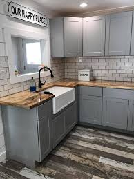light grey kitchen cabinets with wood countertops light gray cabinets wood floor and butcher block counters