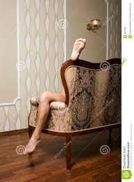 pair of a woman u0027s feet over classic king sofa stock photos image