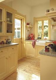 Light Yellow Kitchen Cabinets Yellow Kitchen Cabinets Restyled Home Let The In I