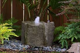 magnificent small garden fountain with pebble and grey base like