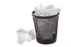 free image of wastepaper basket filled with crumpled paper