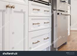 white kitchen cabinet handles and knobs white kitchen built shaker style cabinets stock photo edit