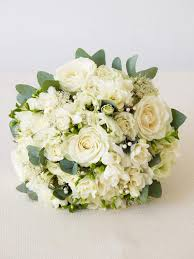 white floral arrangements all dressed in white flower arrangements for a winter